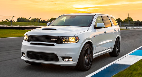 White 2020 Dodge Durango being driven on a race track at sunset